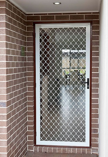 Protect your home with best perforated security door at for Security doors prices
